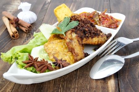 a plates of chicken dishes penyet Standard-Bild