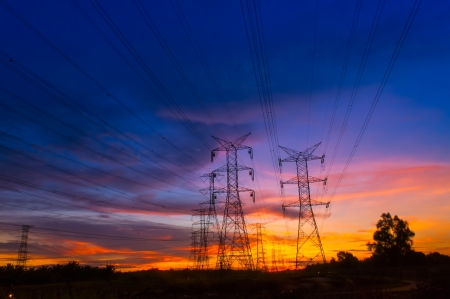 Electricity Pylon at amazing colorful of sunset photo