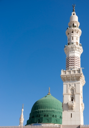 Towers of the Nabawi mosque againts blue sky  Nabawi mosque is Islam