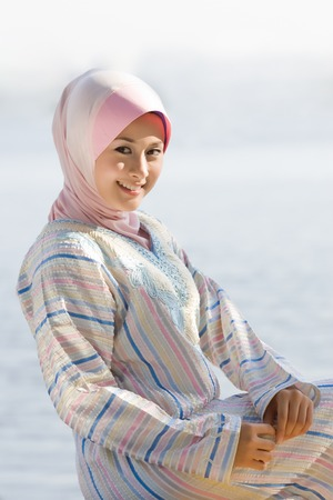 purdah: portrait of a young Muslim girl beside lake Stock Photo