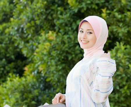purdah: Smiling of the Malay young girl at the park