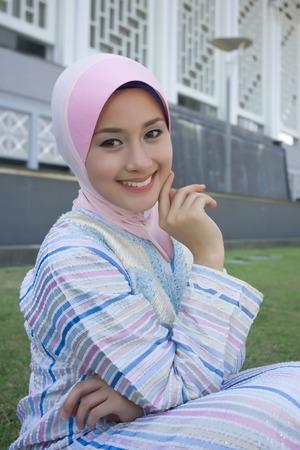 veiled: a seductive smile Stock Photo