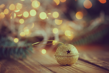 jingle bell: Metal Jingle Bell with star on Wooden Table Stock Photo