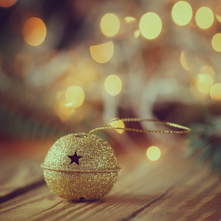 jingle: Metal Jingle Bell with star on Wooden Table Stock Photo