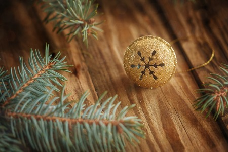 jingle: Gold Metal Jingle Bell with snowflake on Wooden Table. Christmas background Stock Photo