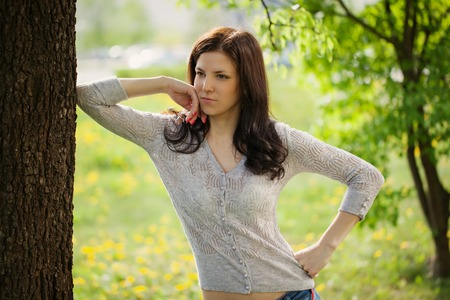 earnest: Portrait of a young beautiful woman - outdoors Stock Photo
