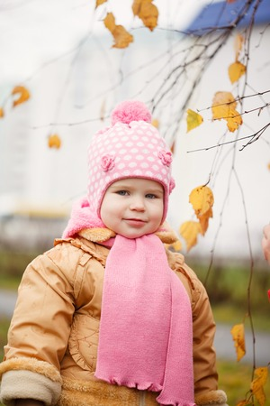 2 years old: Cute smiling little 2 years old girl in the autumn