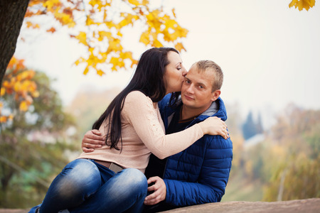 sweet couple: young  lovely sweet couple  kissing in autumn park