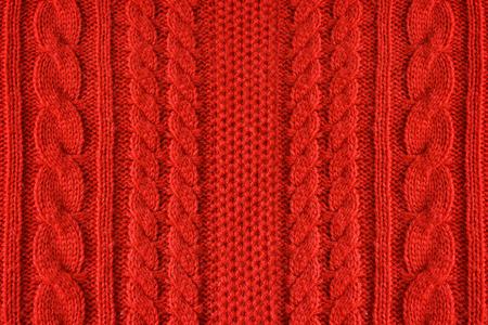 Knitted woolen background, color red texture Standard-Bild