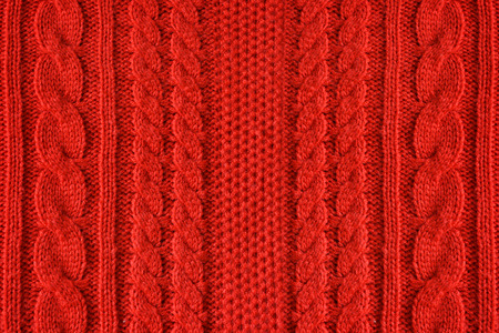Knitted woolen background, color red texture Reklamní fotografie