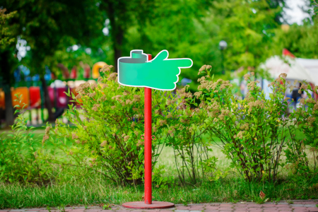 adhere: Notice board, green blank plate for text in the park on natural background