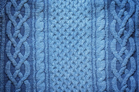counterpane: Knitted woolen background, blue texture. texture from natural yarn