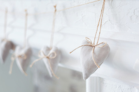 romance: Handmade textile  white  heart  on a white background, rustic style. Romance consept.