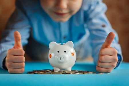 Hands kid and piggy bank or money box Stock Photo