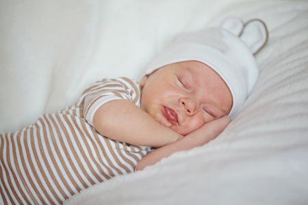 Cute little baby newborn sleeping at home.