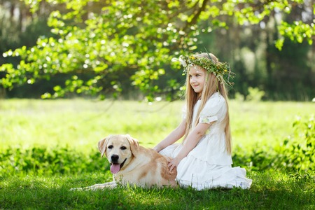 LIttle girl and big dog bestfriend on nature background.