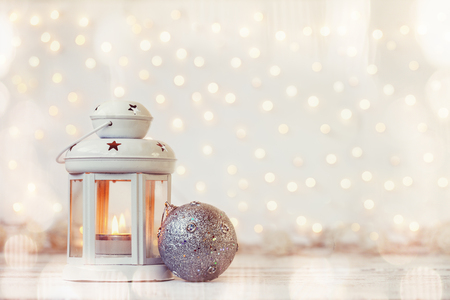 White lantern with candle and silver ball - Christmas decoration Stock Photo
