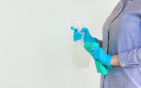 Young woman Cleaning Room. Sanitary at Home. Hands in Rubber Gloves. Housekeeping Concept. Stock Photo