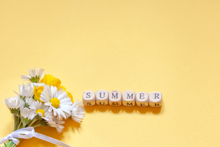 Bouquet flower camomila with text summer on yellow background. Summer consept background Stok Fotoğraf
