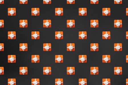 Orange gift box on black background. Halloween concept. Creative design, minimal flat lay concept. Pattern.