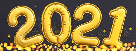 Golden digits 2021 numbers of the Happy New Year lie on a black background. Flat lay, Holiday Party Decoration or postcard concept.