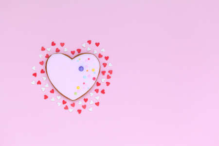Valentine pink heart shaped cookies with small red and white hearts in love. Flatlay holiday concept with copy space.