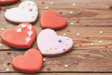 Heart shaped cookies for Valentine's day or Mother's day on wooden background. Holiday concept.