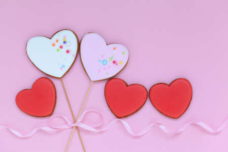 Valentine heart cookies for Valentine's day or Mother's day on pink background. Holiday concept with copy space.