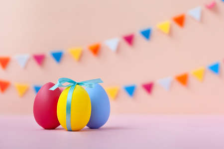 Three colorful easter eggs on pink background. Easter holiday concept. Reklamní fotografie