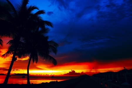 Red and blue color sunset after heavy rain at Marina Jetty Sutera Harbour