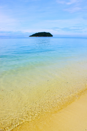Clear water and beautiful sandy beach at Manukan Island photo