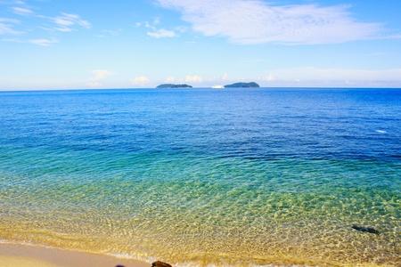 Beautiful water color of sandy beach at Sutera Harbour Beach, Kota Kinabalu, Sabah photo