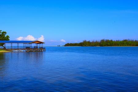 Fisherman Jetty with blue sky and sea at Serusup Village, Tuaran, sabah