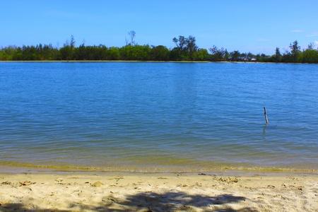 Lansdscape view of sandy beach at Serusup Village, Tuaran, Sabah photo