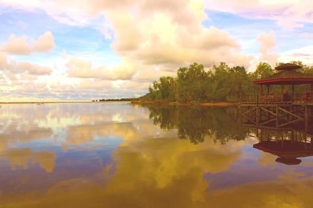 tuaran: Sunset view and water reflection at Mimpian Jadi Beach Resort, Tuaran, Sabah, Malaysia Stock Photo