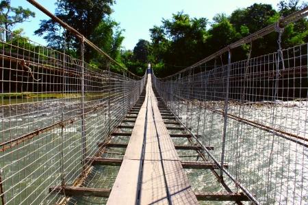 Hang bridge cross over the Kiulu River at Kiulu, Tuaran, Sabah, Malaysia photo