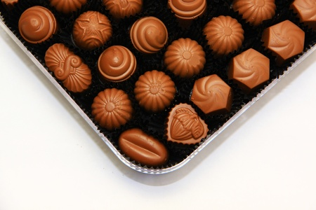 Praline chocolates with variaties of shape in a clear case