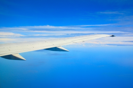 Flight on air with blue background photo