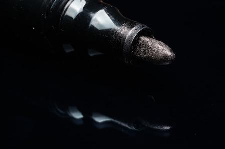 black marker pen isolated on black
