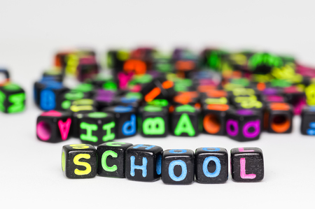 Colorful plastic beads with letters.conceptual image