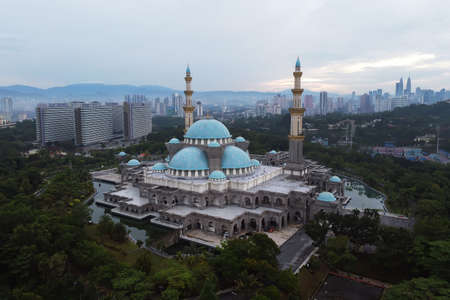 Aerial view of public mosque in Kuala Lumpur during cloudy sunrise