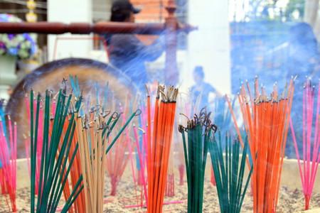 smolder: Bangkok, Thailand. Aroma sticks near the temple. Stock Photo