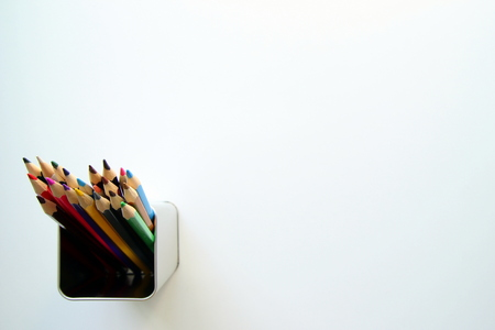 cin: A lot of colored pencils inside a tin can on the white background. Stock Photo