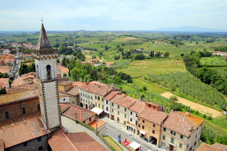 Travel to Vinci, Italy. The view on the city with red roofs and fields of Toscana. Stock Photo