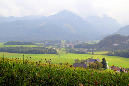wolfgang: Travel to Sankt-Wolfgang, Austria. The view on the green meadow with the mountains on the background.