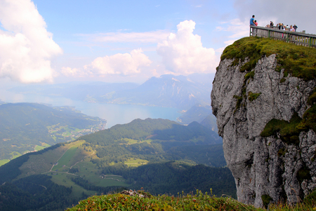 Travel to Sankt-Wolfgang, Austria. The cliff with view on the mountains and a lake in the clouds.