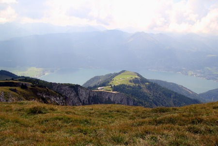 wolfgang: Travel to Sankt-Wolfgang, Austria. The view on the mountains and a lake in the clouds.
