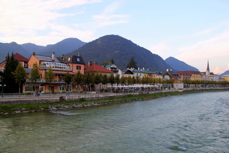 wolfgang: Travel to Sankt-Wolfgang, Austria. The view on a city and a river with the mountains on the background.