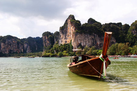 Travel to Krabi, Thailand. The view on the long boat on a coast of sea from Railay Beach.