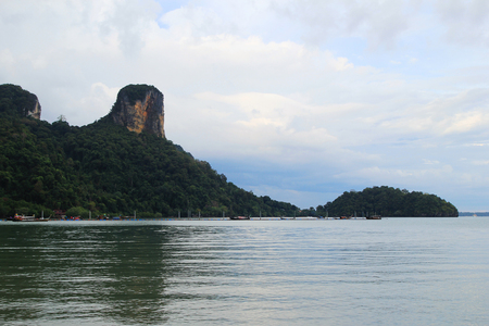 Travel to Krabi, Thailand. The scenic view on a sea and the cliffs from Ao Nang Beach. Stock Photo
